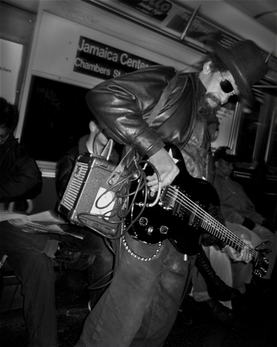 The J Line Subway: I always see this musician performing on the J train, I always give him something as I'm impressed that he goes through the trouble to bring his own mini-amp with him.